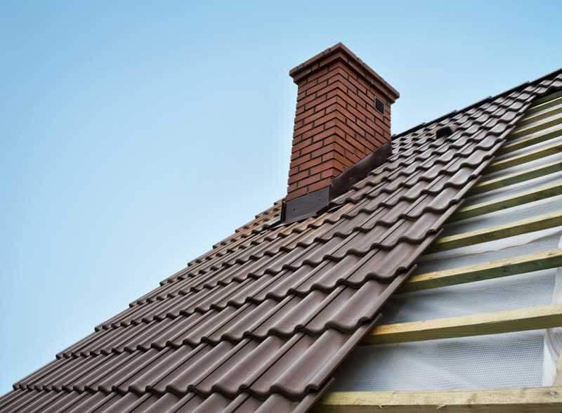 Schoorsteenrenovatie bij vervangen van dakpannen